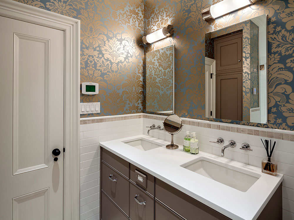Bathroom with double sinks and ornate wallpaper pattern